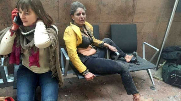 Two wounded women sit in the airport in Brussels, Belgium, after two explosions rocked the facility on March 22, 2016. A subway station in the city was also targeted in terrorist attacks that killed at least 30 people and injured hundreds more. Investigators say the suspects belonged to the same ISIS network that was behind the Paris terror attacks in November.