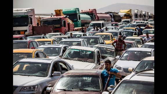 Traffic from Mosul lines up at a checkpoint in Kalak, Iraq, on June 14, 2014. Thousands of people fled Mosul after it was overrun by ISIS.