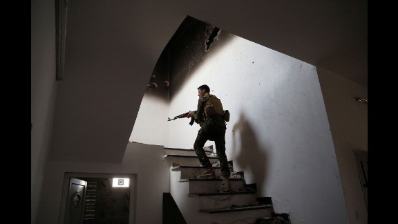 An Iraqi soldier searches for ISIS fighters in Tikrit on March 30, 2015. Iraqi forces retook the city after it had been in ISIS control since June 2014.
