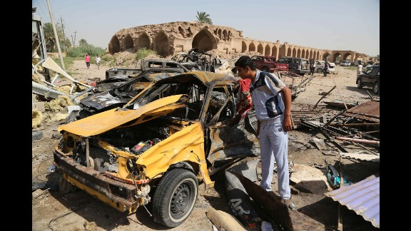 A man inspects the aftermath of a car bombing in Khan Bani Saad, Iraq, on July 18, 2015. A suicide bomber with an ice truck, promising cheap relief from the scorching summer heat, lured more than 100 people to their deaths. ISIS claimed responsibility on Twitter.