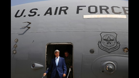 U.S. Secretary of State John Kerry arrives at Baghdad International Airport in Baghdad, Iraq, on Friday, April 8. The unannounced visit is part of an effort to shore up an embattled prime minister fighting to stay in office.