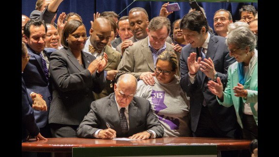 California Gov. Jerry Brown signs legislation Monday, April 4, that makes his state the first in the nation to raise the minimum wage to $15 an hour.