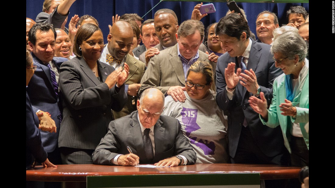 "California Gov. Jerry Brown signs legislation Monday, April 4, that makes his state <a href=""http://money.cnn.com/2016/03/31/pf/california-minimum-wage/"" target=""_blank"">the first in the nation</a> to raise the minimum wage to $15 an hour."