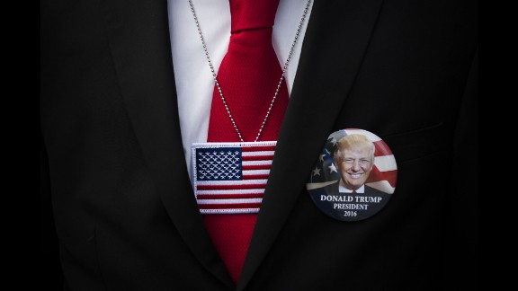 A supporter wears a button for presidential candidate Donald Trump during a Trump event in Bethpage, New York, on Wednesday, April 6.