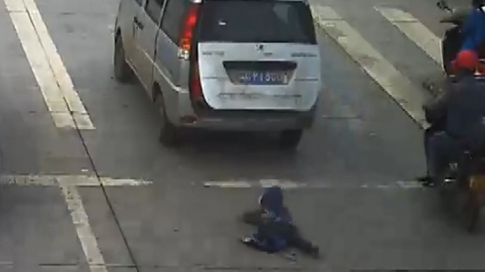 Child falls from moving car into busy road - CNN Video