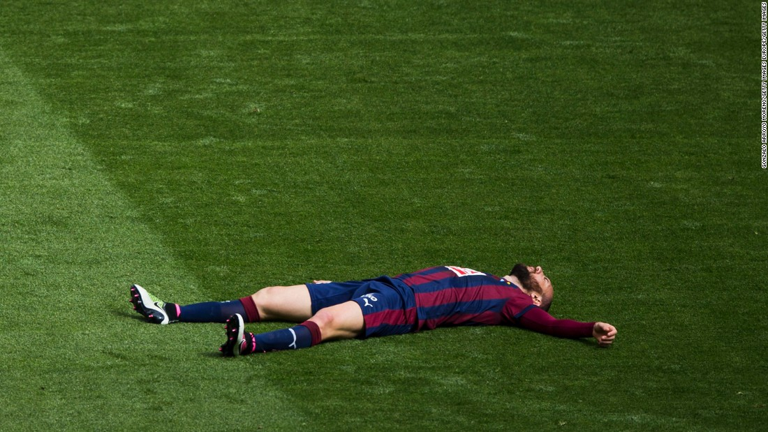 Ivan Ramis of Eibar lies flat out on the grass as his side is steamrollered by Real Madrid at the Santiago Bernabeu.