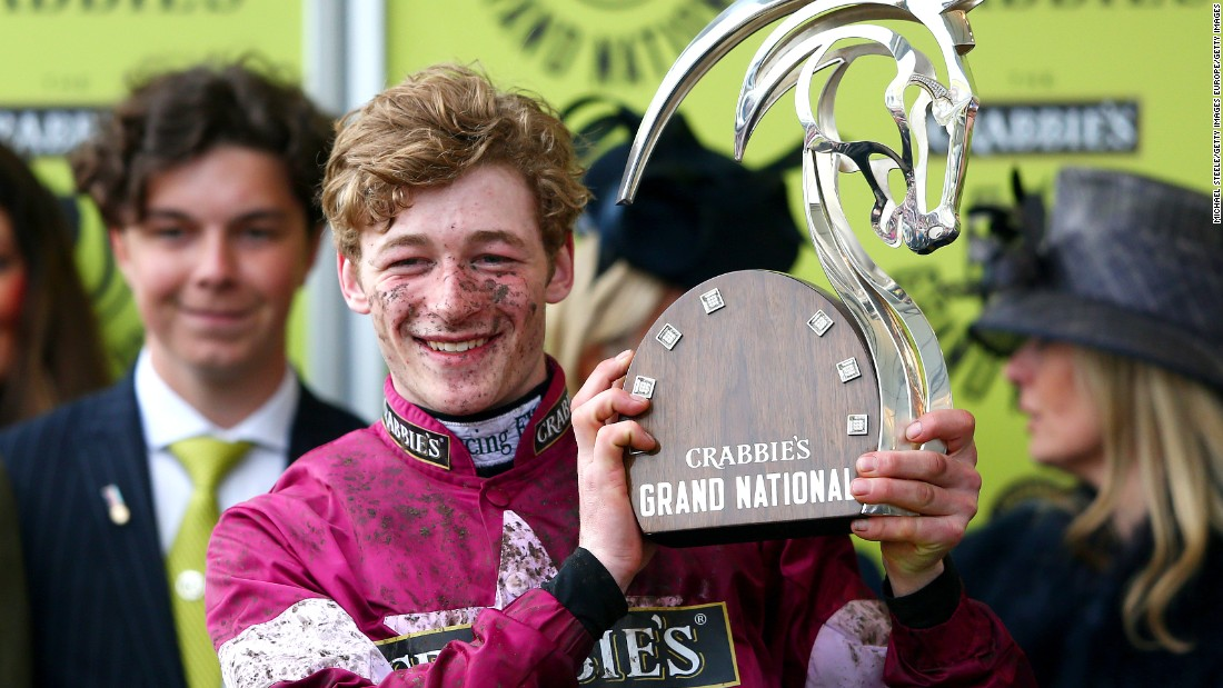 To the winner, the spoils. David Mullins poses for the cameras in the winners' enclosure.
