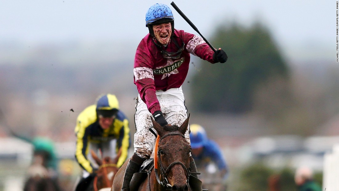 David Mullins, riding Rule The World, celebrates winning the 2016 Grand National steeplechase at the Aintree Racecourse in Liverpool, England.