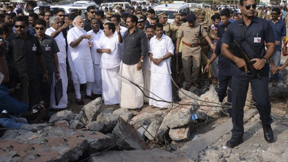 Indian Prime Minister Narendra Modi, second left, wearing white, visits the site.