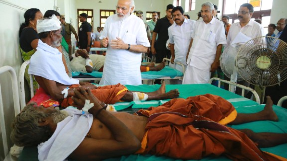 Modi, center, visits the injured victims at the Kollam district hospital.