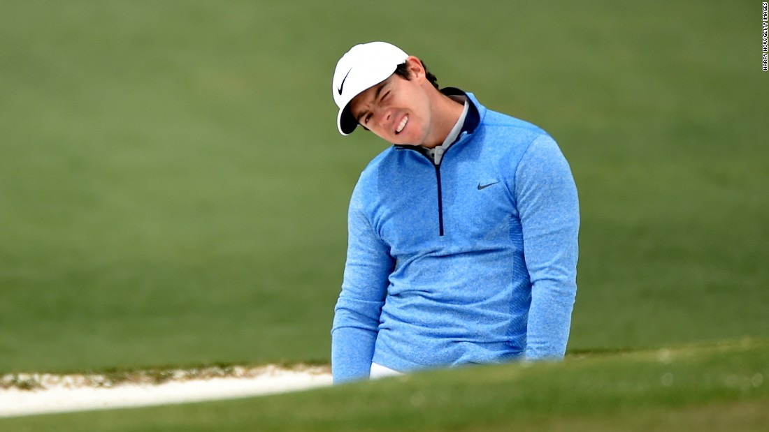 Rory McIlroy reacts to a bunker shot on the second hole Sunday.