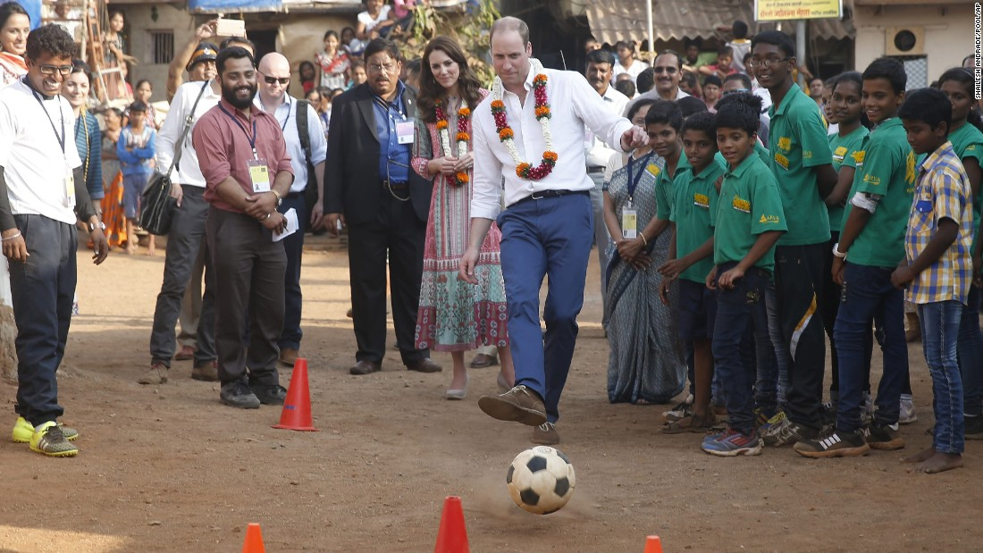 Prince William plays soccer during a visit to a Mumbai slum on April 10.