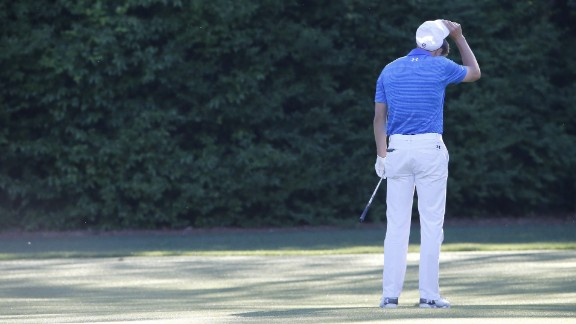 Spieth, the defending champion, was comfortably in first until the 12th hole, when he hit the ball into the water twice and finished with a quadruple-bogey.