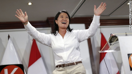 Peru´s presidential candidate of the 'Fuerza Popular' party, Keiko Fujimori, waves at supporters after a press conference in Lima on April 10, 2016. Keiko Fujimori, daughter of an ex-president jailed for massacres, topped the first-round vote Sunday in troubled elections that will make her Peru's first female leader if she wins a runoff. / AFP / LUKA GONZALES (Photo credit should read LUKA GONZALES/AFP/Getty Images)