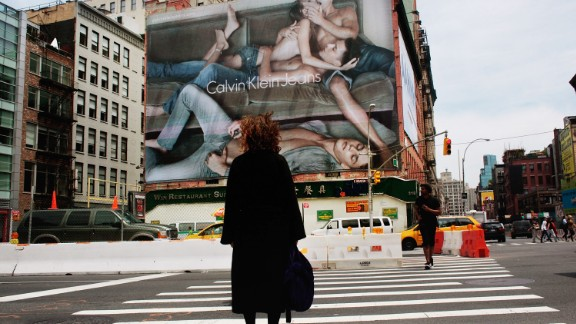 A Calvin Klein billboard in the SoHo neighborhood of New York City in 2009. The provocative ad featuring a topless model and three young men has provoked controversy in the city.
