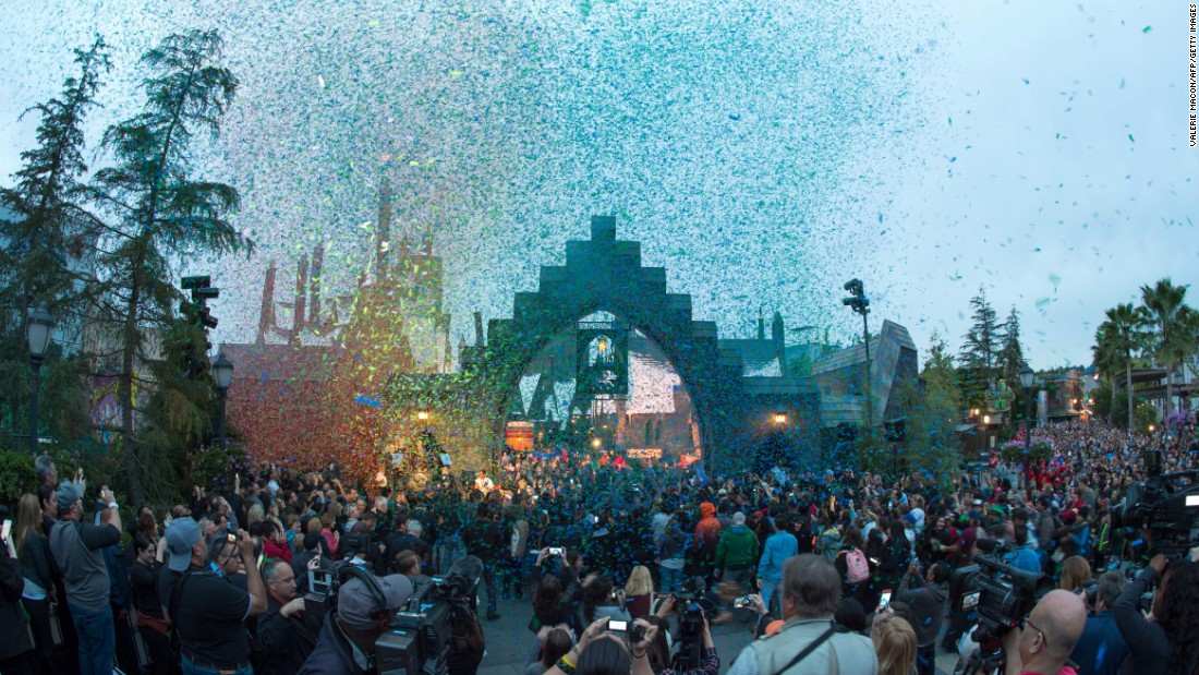"Visitors arrived before dawn to be among the first to enter Wizarding World's ""Hogsmeade"" village on opening day."