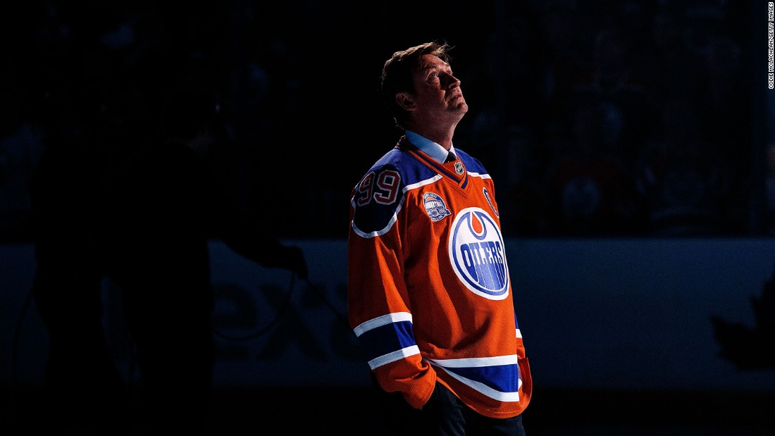 Hockey great Wayne Gretzky looks up at the Rexall Place rafters after the arena hosted its final game in Edmonton, Alberta, on Wednesday, April 6. The Edmonton Oilers are moving into a new building next season.