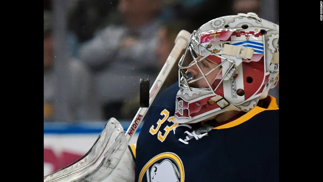 Buffalo goaltender Jason Kasdorf, making his NHL debut, takes a puck off the mask on Friday, April 8.