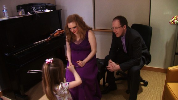 Four-year-old Sylvia Pine practices in front of her parents in her mother's dressing room.