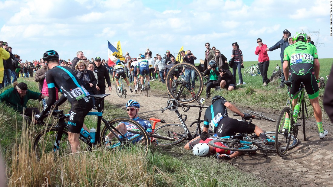 Cyclists fall on a cobblestoned section of the Paris-Roubaix, a one-day road race in France on Sunday, April 10.