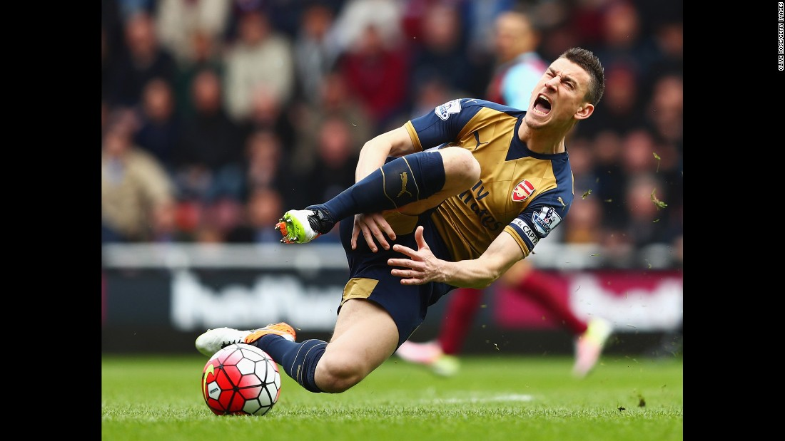 Arsenal's Laurent Koscielny reacts to a tackle by West Ham's Andy Carroll during a Premier League match in London on Saturday, April 9.