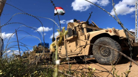 Iraqi soldiers in their vehicles hold a position on the frontline on the outskirts of Makhmur, about 280 kilometres (175 miles) north of the capital Baghdad, on March 30, 2016, during a military operation to recapture the northern Nineveh province from Islamic State group jihadists.  Iraqi army troops and allied paramilitary fighters on March 24 launched a major offensive aimed at retaking the northern Nineveh province, the capital of which, Mosul, is the main hub of IS in Iraq. The forces have been advancing from their base in Makhmur towards the town of Qayyarah, about 60 kilometres (35 miles) south of Mosul.   / AFP / SAFIN HAMED        (Photo credit should read SAFIN HAMED/AFP/Getty Images)