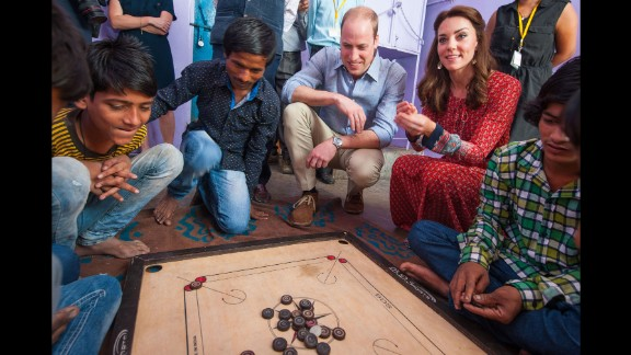 William and Catherine play a game with children at a New Delhi railway station on April 12.
