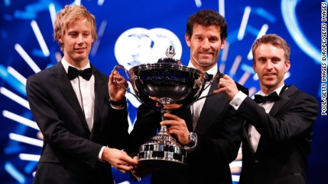 Three's the magic number: Mark Webber (center) and Porsche teammates Brendon Hartley (left)and Timo Bernhard (right) collect their WEC prize.