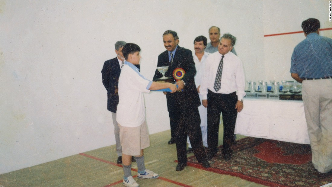 Receiving her first squash trophy. She won the under-13 category at the 2002 Hashim Khan Junior Squash Championship.
