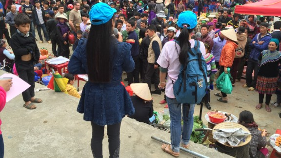Two girls who have escaped trafficking and returned to Vietnam share their personal experiences to warn others at a market in Northern Vietnam.