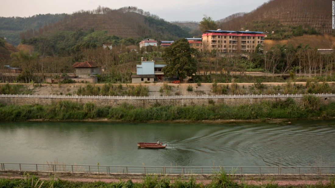 Girls say they are tricked or drugged, then taken across the border by boat, motorbike or car. This river marks the boundary between China and Vietnam in Lao Cai, and is frequently crossed by smugglers.