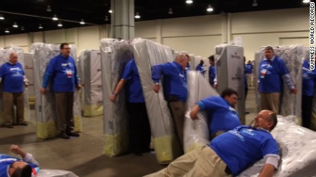 title: Largest human mattress dominoes - Guinness World Records duration: 00:01:56 site: Youtube author: null published: Thu Apr 07 2016 12:48:45 GMT-0400 (Eastern Daylight Time) intervention: no description: Aaron's Inc., an appliance and electronics company in the US, broke the record for the Largest human mattress dominoes with 1,200 participants at the Gaylord Resort and Conference Center in National Harbor, Maryland, USA. The feat was accomplished in its first try and took 13 minutes and 38 seconds.  The attempt was part of their annual managers meeting. Read the full story here: http://bit.ly/GWR-MattressTopple  Subscribe for more: http://bit.ly/subscribetoGWR  Welcome to the official Guinness World Records YouTube channel!  If you're