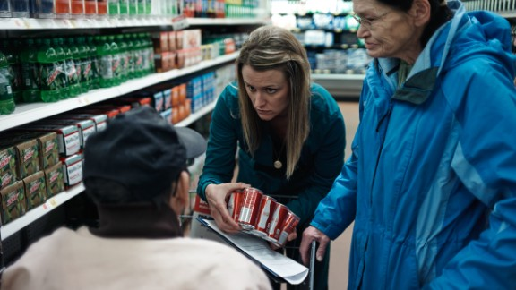 Jami Larson, 32, is a member of Lower Brule Sioux Tribe. She is a RN and specializes in diabetes among Native Americans in Pierre, South Dakota. She goes food shopping with her diabetic patients to better explain how food labels work and which types of food to avoid.