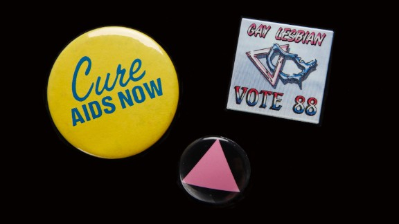 """The AIDS epidemic moved many people out of the closet and into the streets to fight for greater acceptance. Pins were an easy way to signal support. The pink triangle honored LGBT victims of the Holocaust and was a """"reminder of the Holocaust perpetrated by our governments refusing to deal with AIDS,"""" said Cathy Woolard in 1989. Woolard, an Atlanta LGBT organizer, went on to be the Atlanta City Council's first female president. The buttons belonged to Richard Rhodes, a Navy veteran and community organizer who became the first known gay candidate to run for the Georgia House in 1988, and was the first known gay delegate to the Democratic National Convention from Georgia. Every year on his birthday he would get an HIV test. AT 65, he tested HIV-positive. He remains an activist and an advocate for HIV testing."""