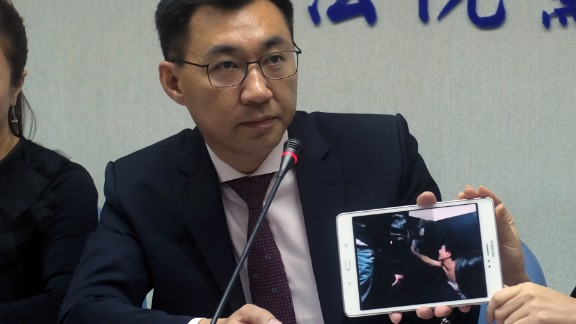 Taiwanese legislator Johnny Chiang shows a video image from the Kenyan jail cell.