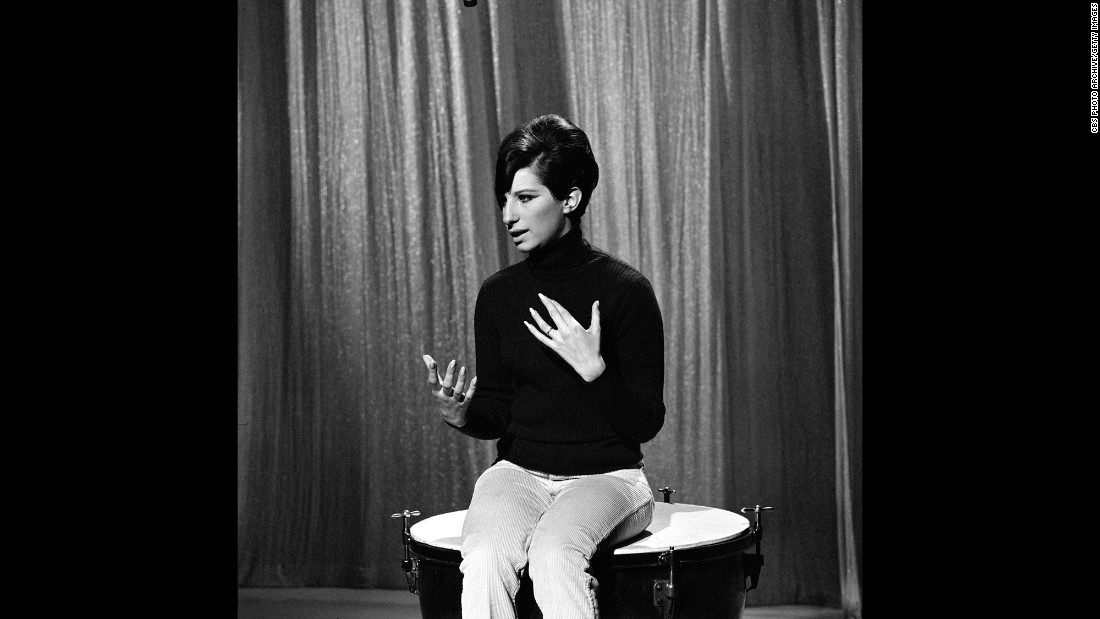 Streisand sits on a kettledrum during a rehearsal.