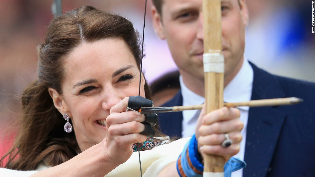 Prince William watches as his wife fires an arrow during an archery demonstration in Paro, Bhutan, on April 14.