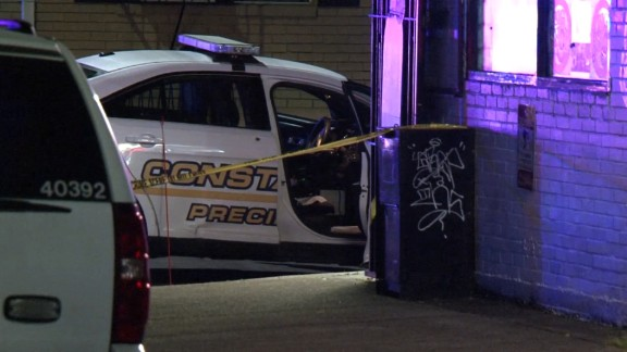 Police say a Harris County deputy constable was shot in the back while talking to his partner.
