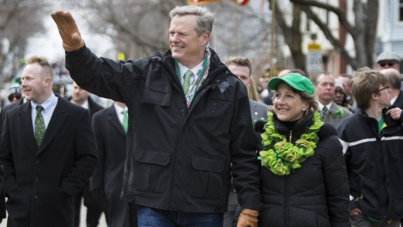 Gov. Charlie Baker of Massachusetts and wife Lauren Baker march in the annual South Boston St. Patrick