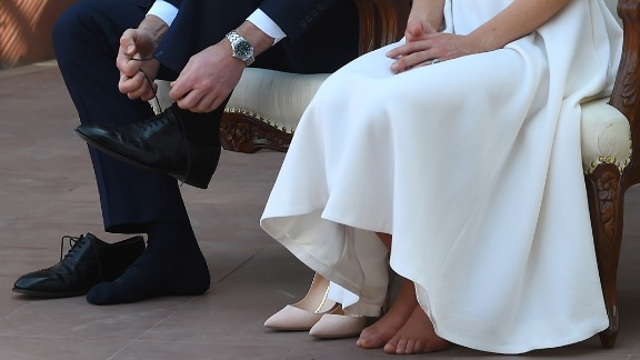 The couple removes their shoes as they pay respect at Gandhi Smriti on April 11. The house is where Mahatma Gandhi, India's founding father, spent the last few years of his life.