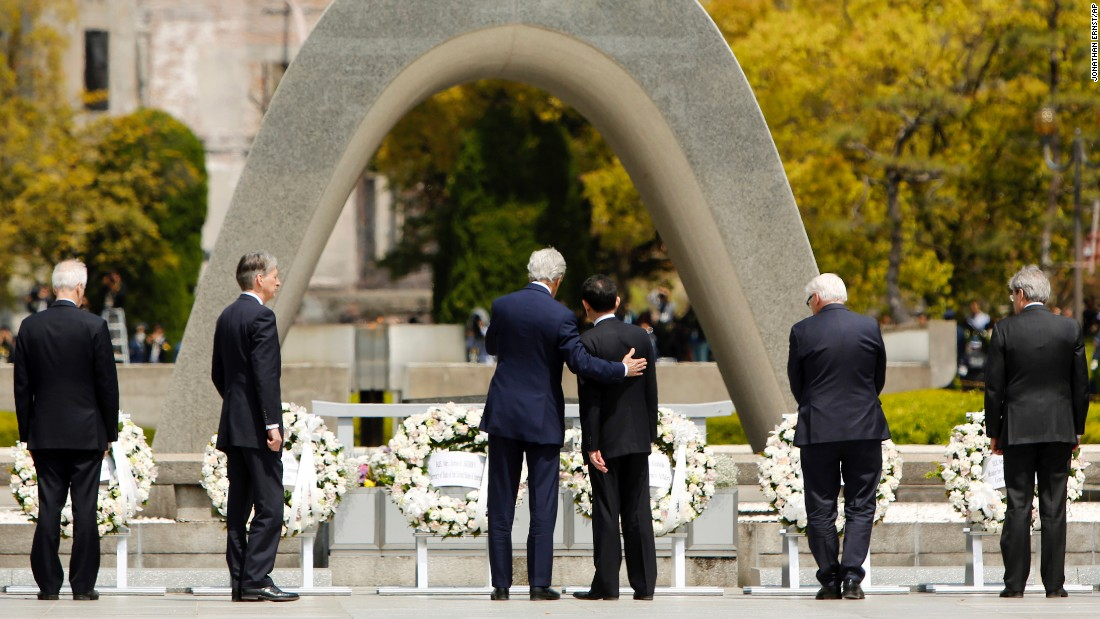 "U.S. Secretary of State John Kerry puts his arm around Japanese Foreign Minister Fumio Kishida after G-7 foreign ministers laid wreaths at the Hiroshima Peace Memorial Park in Hiroshima, Japan, on Monday, April 11. Kerry is <a href=""http://www.cnn.com/2016/04/11/politics/john-kerry-hiroshima-memorial/"" target=""_blank"">the first sitting secretary of state</a> to visit the memorial."