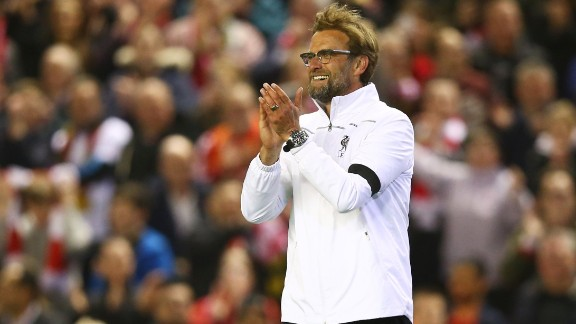 Klopp celebrates victory after Liverpool's implausibe Europa League quarterfinal win.