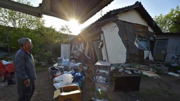 A man stands in front of his collapsed house in Mashiki on April 15.