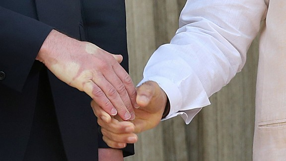 A strong handshake by Modi leaves an impression on Prince William's hand on April 12.