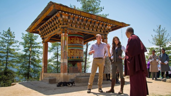 Britain's Prince William and his wife Catherine, the Duchess of Cambridge, chat with a monk in Thimphu, Bhutan, on Friday, April 15.