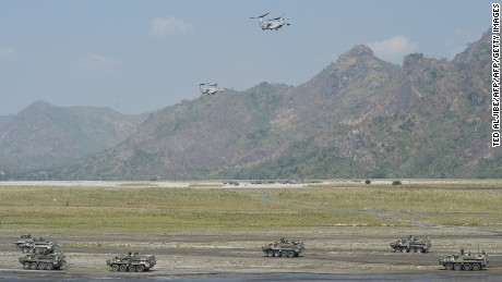 Two V-22 Osprey aircraft hover above armored personnel carriers of the Philippine army and U.S. marines during the drills.