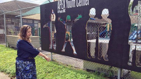 Lisa Fitzpatrick points to where a young man collapsed in front of APEX Youth Center last month.