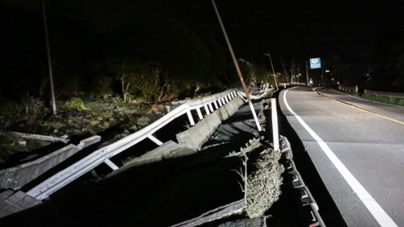 A road damaged by the 7.0 magnitude earthquake is seen on April 16 in Mashiki, Kumamoto, Japan.