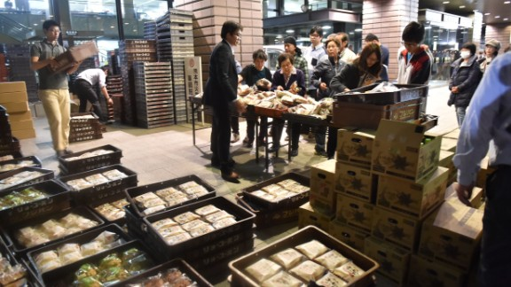 Evacuees wait for food at an entrance of the Kumamoto City Hall on April 16.