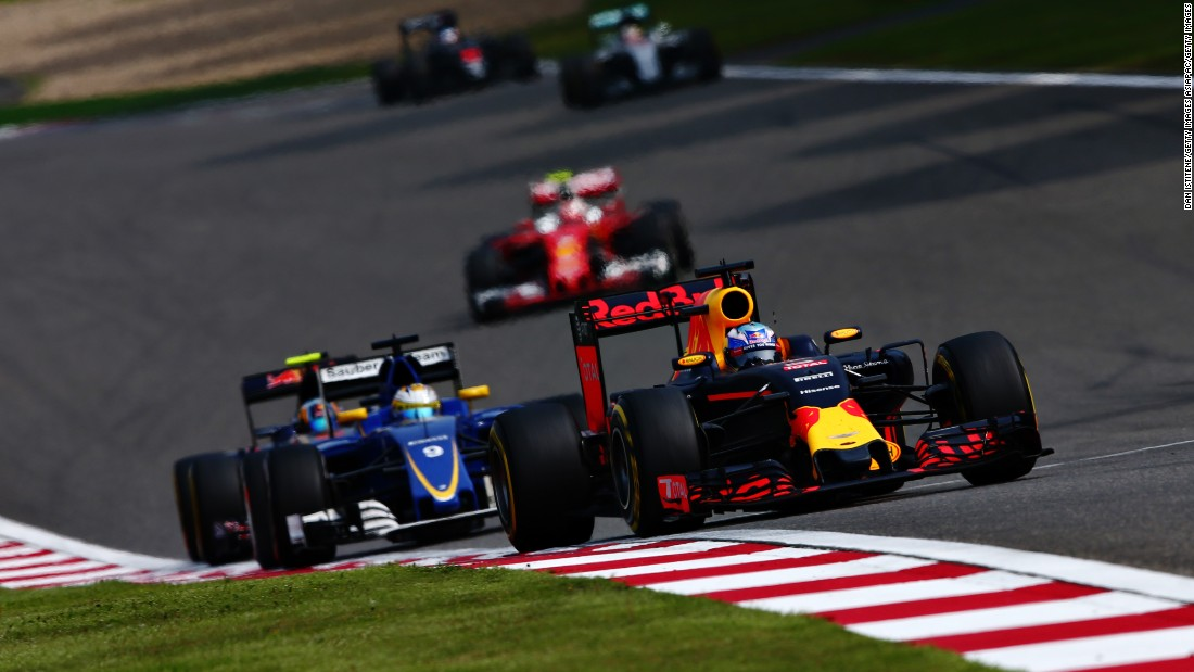 Daniel Ricciardo of Australia driving the (3) Red Bull Racing Red Bull-TAG Heuer RB12 TAG Heuer leads Marcus Ericsson of Sweden driving the (9) Sauber F1 Team Sauber C35 Ferrari 059/5 turbo on track during the Formula One Grand Prix of China.